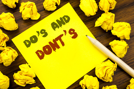 Word, writing Do s And Do Not Donts. Business concept for Guide Allowed Written on sticky note paper, wooden background folded yellow paper meaning thinking Stock fotó