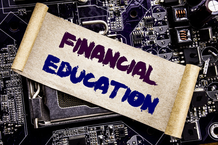 Hand writing text caption inspiration showing Financial Education. Business concept for Finance Knowledge Written on sticky, computer main board background.