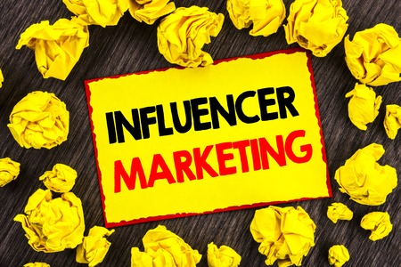 Handwriting Announcement text  Influancer Marketing. Conceptual photo Social Media Online Influence Strategy written Yellow Stikcy Note Folded Paper the wooden background