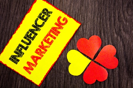 Text showing Influancer Marketing. Business photo showcasing Social Media Online Influence Strategy written Sticky Note Paper with Love Heart Next to it the wooden background.