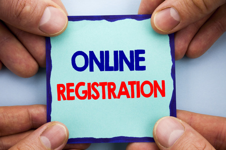 Handwriting Announcement text showing Online Registration. Business photo showcasing Register Web Subscription Subscribe written Sticky Note Paper Holding Hand with Finger.