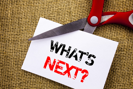 Handwriting text showing What is Next Question. Conceptual photo Next Future Plan Vision Progress Goal Guidance written Sticky Note Paper Cutting by Scissors the textured background