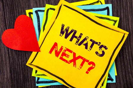 Writing text showing  What is Next Question. Concept meaning Next Future Plan Vision Progress Goal Guidance written Stikcy Note Paper the wood background Love Heart Stock Photo