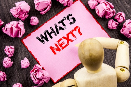 Conceptual hand text showing What is Next Question. Concept meaning Next Future Plan Vision Progress Goal Guidance written Sticky Note Holding By Sculpture the wooden background. Stock Photo