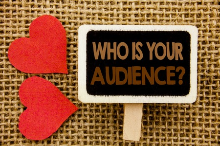 Conceptual hand text showing Who Is Your Audience Question. Business photo showcasing Customer Target Service Client Research written blackboard the textured background with Love Heart