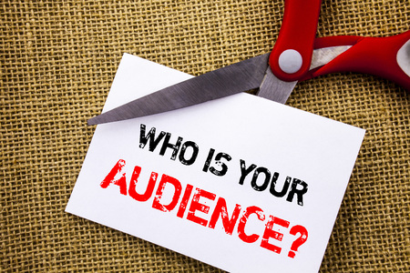 Handwriting text showing Who Is Your Audience Question. Conceptual photo Customer Target Service Client Research written Sticky Note Paper Cutting by Scissors the textured background Stok Fotoğraf