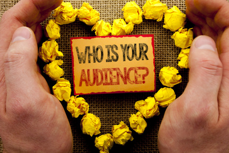 Conceptual writing showing Who Is Your Audience Question. Business photo showcasing Customer Target Service Client Research written Sticky Note Paper With Heart Holding Hand with Finger