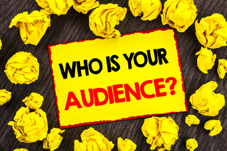 Handwriting Announcement text  Who Is Your Audience Question. Conceptual photo Customer Target Service Client Research written Yellow Stikcy Note Folded Paper the wooden background Stok Fotoğraf - 96873446