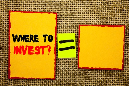 Text showing Where To Invest Question. Business photo showcasing Financial Income Investing Plan Advice Wealth written Sticky note Paper EquatiFor Your Own Text textured background Stock Photo