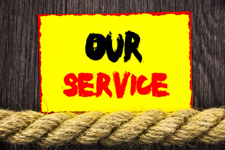 Handwritten text sign showing Our Service. Conceptual photo Customer Marketing Support Help Concept Helping Your Client written Sticky note next to the rope the wooden background.