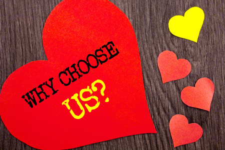 Handwriting Announcement text showing Why Choose Us Question. Concept meaning Reason Of Choice Customer Satisfaction Advantage written Heart Love the wooden background. Stock Photo