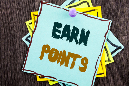 Word, writing, text  Earn Points. Business concept for Loyalty Reward Benefit Program For Earning Customer Point written Blue Sticky Note Paper the wooden background.