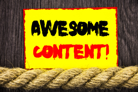 Handwritten text sign showing Awesome Content. Conceptual photo Creative Strategy Education Website Concept written Sticky note next to the rope the wooden background.
