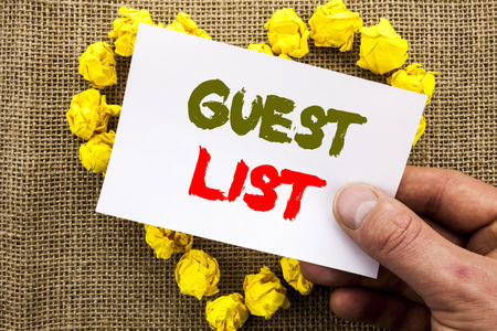 Handwritten text sign showing Guest List. Conceptual photo Planning Wedding Or Event Important Guests Lists written Sticky Note Paper With Heart Holding Hand with Finger. Stock Photo - 96900786