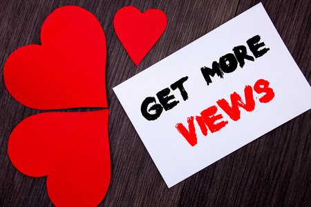 Writing text showing  Get More Views. Concept meaning More Traffic Leads Online Page Promotion Popularity Traffic written on notobook paper note on  wooden background with Love Heart.