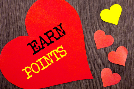 Handwriting Announcement text showing Earn Points. Concept meaning Loyalty Reward Benefit Program For Earning Customer Point written Heart Love the wooden background.