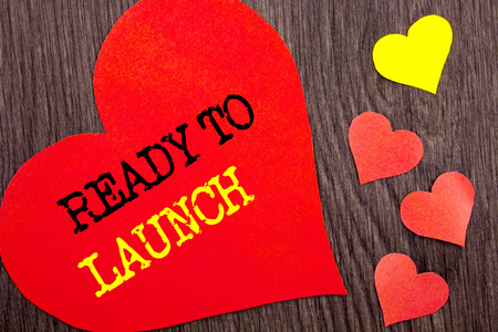 Handwriting Announcement text showing Ready To Launch. Concept meaning Prepare New Product Promotion Start Release written Heart Love the wooden background.