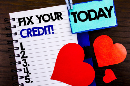 Announcement text showing Fix Your Credit. Concept meaning Bad Score Rating Avice Fix Improvement Repair written notebook book paper the wooden background Today Love Heart.