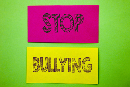 Handwriting Announcement text showing Stop Bullying. Conceptual photo Awareness Problem About Violence Abuse Bully Problem written sticky note paper the green background.