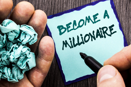 Announcement text showing Become A Millionaire. Business concept for Ambition To Become Wealthy Earn Fortune Fortunate written Notebook Book Man Writing Holding Pen wooden background. 写真素材