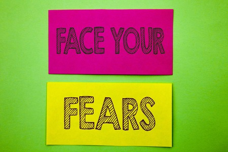 Handwriting Announcement text showing Face Your Fears. Conceptual photo Challenge Fear Fourage Confidence Brave Bravery written sticky note paper the green background.