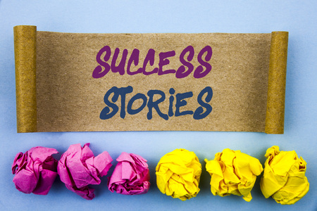 Handwriting text showing Success Stories. Concept meaning Successful Inspiration Achievement Education Growth written tear sticky note Paper the blue background Folded paper