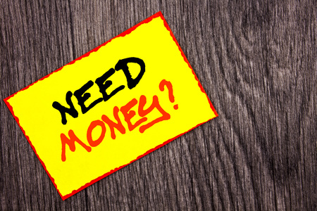 Conceptual hand writing text showing Need Money Question. Concept meaning Economic Finance Crisis, Cash Loan Needed written Yellow Sticky Note Paper the wooden background.