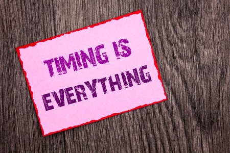 Handwriting Announcement text showing Timing Is Everything. Conceptual photo Important Success Advice To Be Ready For Precision written Pink Sticky Note Paper the wooden background. 스톡 콘텐츠