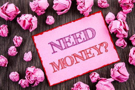Handwriting text showing Need Money Question. Business photo showcasing Economic Finance Crisis, Cash Loan Needed written Pink Sticky Note Paper Folded Paper wooden background