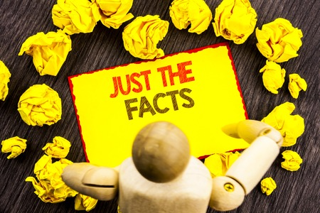Writing text showing  Just The Facts. Business photo showcasing Truth Fact Accuracy Honest Concept For Factual Actual  written Sticky Note Holding By Sculpture the wooden background