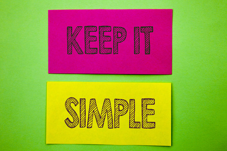 Handwriting Announcement text showing Keep It Simple. Conceptual photo Simplicity Easy Strategy Approach Principle written sticky note paper the green background. Banco de Imagens