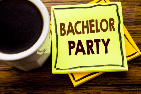 Handwritten text showing Bachelor Party. Business concept for Stag Fun Celebrate written on sticky note paper on wooden wood background with coffee cup