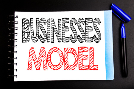 Handwritten text showing Businesses Model. Business concept writing for Project For Business Written on notepad paper, black background with space office view with pencil marker