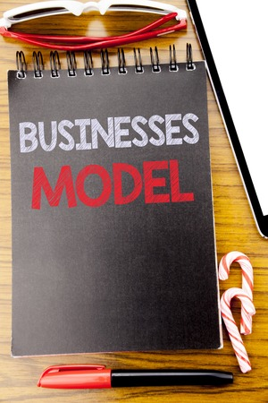 Word, writing Businesses Model. Business concept for Project For Business Written on notebook book, wooden background with sticky sunglasses and red pen