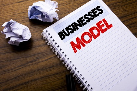 Writing text showing Businesses Model. Business concept for Project For Business written on notebook notepad note paper on wooden background with folded paper meaning thinking for idea Stock Photo