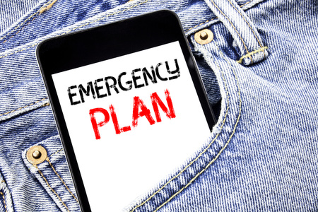 Handwriting Announcement text showing Emergency Plan. Business concept for Disaster Protection Written phone mobile phone, cellphone placed in man front jeans pocket.
