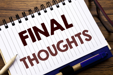 Hand writing text caption inspiration showing Final Thoughts. Business concept for Conclusion Summary Text Written on notebook paper, wooden background with glasses pen and marker. 写真素材