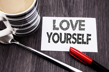 Conceptual hand writing text caption showing Love Yourself. Business concept for Positive Slogan For You written on sticky note paper on wooden wood background. With coffee and marker