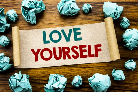 Word, writing Love Yourself. Business concept for Positive Slogan For You Written on sticky note paper, wooden background folded yellow paper meaning thinking