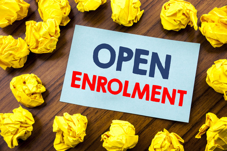 Conceptual hand writing text inspiration showing Open Enrolment. Business concept for Medicine Doctor Enroll written on sticky note paper the wooden background with folded yellow paper