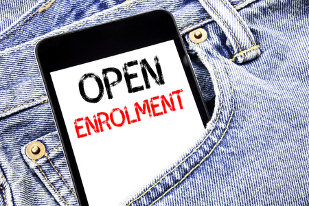 Handwriting Announcement text showing Open Enrolment. Business concept for Medicine Doctor Enroll Written phone mobile phone, cellphone placed in man front jeans pocket.