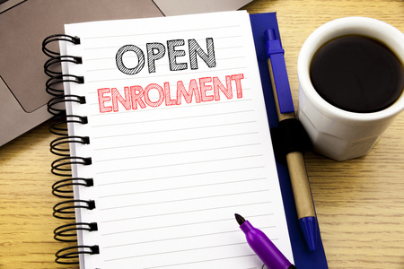 Word, writing Open Enrolment. Business concept for Medicine Doctor Enroll written on notebook book on wooden background in the Office with laptop coffee
