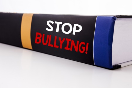 Conceptual hand writing text caption inspiration showing Stop Bullying. Business concept for Prevention Problem Bully written on the book the white background.