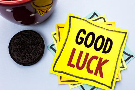 Writing note showing  Good Luck. Business photo showcasing Lucky Greeting Wish Fortune Chance Success Feelings Blissful written Yellow Sticky Note Paper the plain background Cup.