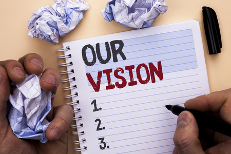 Text sign showing Our Vision. Conceptual photo Innovation Strategy Mission Goal Plan Dream Aim Direction written by Man Notebook Book holding Marker Plain background Stock Photo