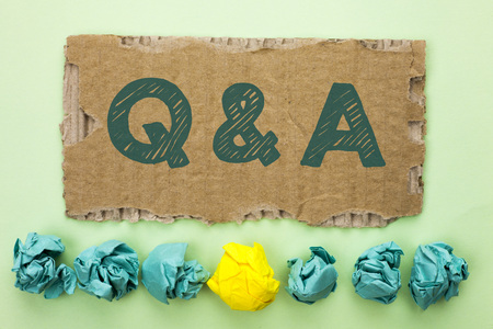 Conceptual hand writing showing Q A. Business photo text Ask Frequently Faq Asked Question Help Solving Doubt Query Support written Tear Cardboard plain background Crumpled Paper Balls. Фото со стока