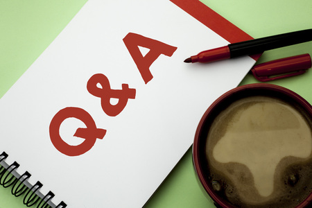 Handwriting text writing Q A. Concept meaning Ask Frequently Faq Asked Question Help Solving Doubt Query Support written Notebook Book the plain background Coffee Cup next to it.