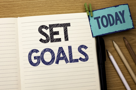 Text sign showing Set Goals. Conceptual photo Target Planning Vision Dreams Goal Idea Aim Target Motivation written Notebook Book the wooden background Today Pencil next to it.