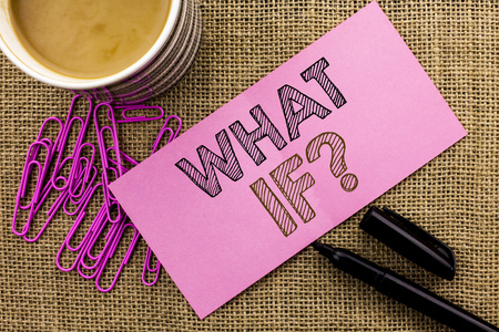 Handwriting text writing What If Question. Concept meaning What Mean Question Ask Frequently Help Solving Support Faq written Pink Sticky Note Paper the jute background Coffee Cup Pen Pins.