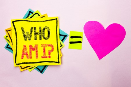 Text sign showing Who Am I Question. Conceptual photo Question Asked Identity Thinking Doubt Psycology Mystery written Stacked Sticky Note Papers the plain background with Heart next to it. Stock Photo